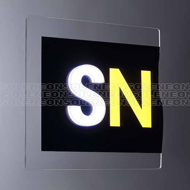 Illuminated signs on glass with non-traslucent background and letters in relief